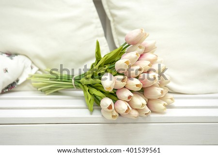 Bouquet of tulips on a white bench - stock photo