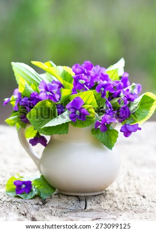 Bouquet of violet flowers on the table - stock photo