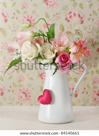 Bouquet of white and pink roses in the pot decorated by heart - stock photo