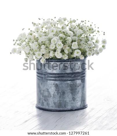 bouquet of white gypsophila babys breath flowers on wooden background