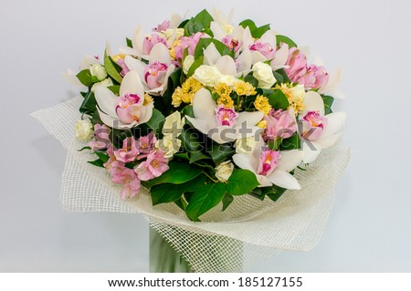bouquet of white orchids. gray background