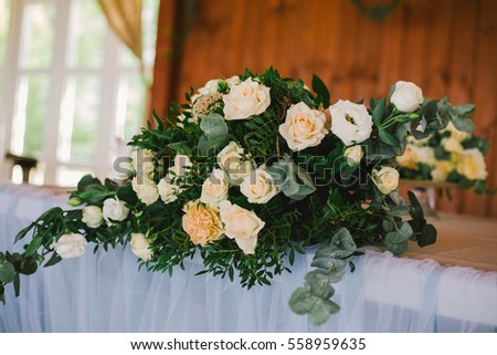 bouquet of white roses on the wedding table