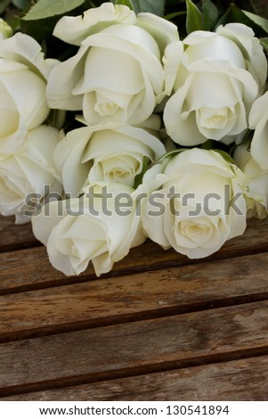 bouquet of white roses  on wooden table