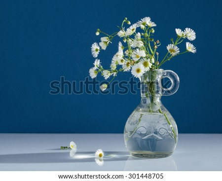 Bouquet of wild flowers in a glass vase - stock photo