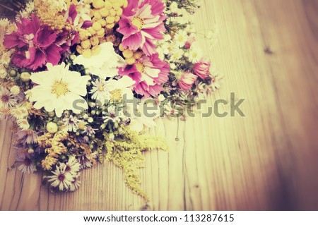Bouquet of Wild Summer Flowers on Wooden Table - Vintage Look - stock photo