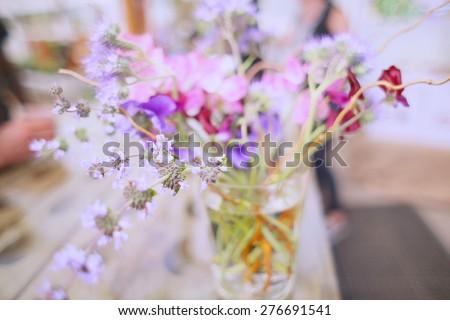 Bouquet of wildflowers in glass mason jar feminine trend - stock photo