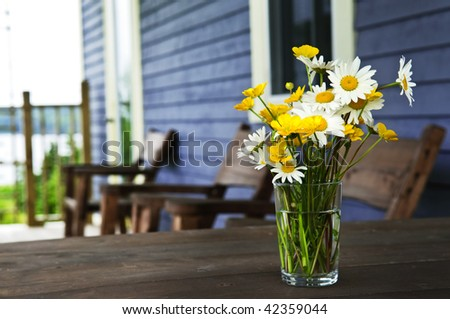 Bouquet of wildflowers on a rustic table at country cottage - stock photo