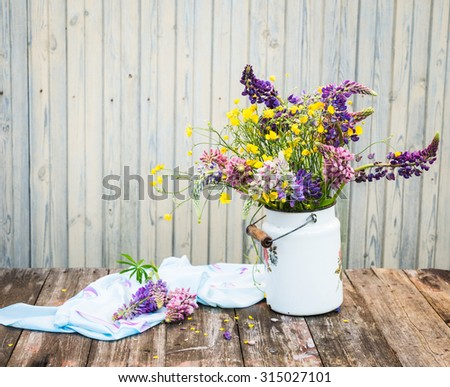 Bouquet of wildflowers. Summer flowers. Lupines and Buttercups. Vintage floral background. - stock photo
