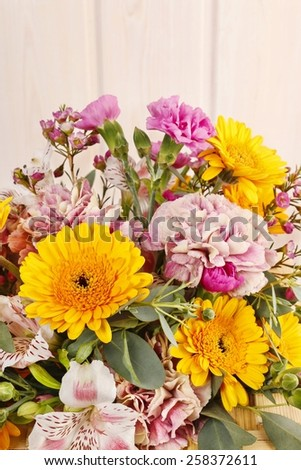 Bouquet of yellow gerbera daisies and pink carnations - stock photo
