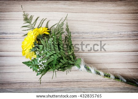 Bouquet of yellow gerbera daisies on the wooden background. Birthday gift. Yellow flowers. Still life. Holiday symbol. Big bouquet. - stock photo