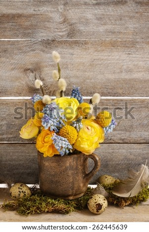 Bouquet of yellow ranunculus (Persian buttercup) and blue muscari (Grape hyacinth) flowers, copy space - stock photo