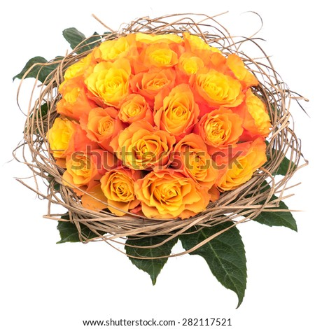 Bouquet orange roses with green leaves in straw ornament isolated on white background, top view - stock photo