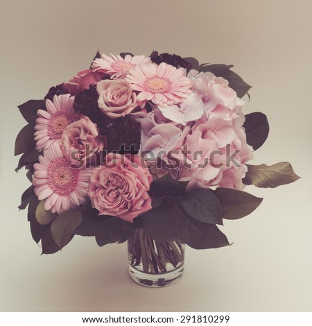 Bouquet pink flowers in vase, vintage toned - stock photo