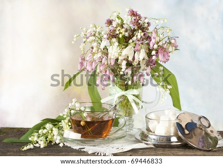 bouquet sunflowers  in vase and tea - stock photo