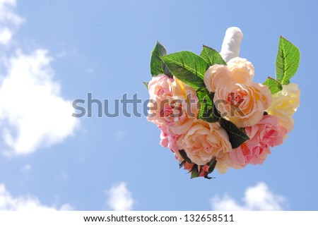 bouquet toss in the sky - stock photo