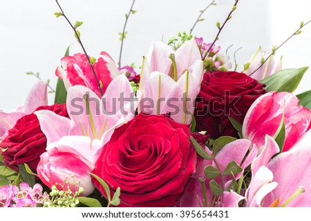 Bouquet wit redroses and pink flowers on a white background - stock photo