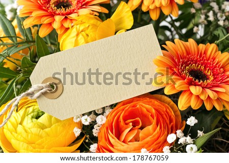 bouquet with gerbera  and buttercups with card/flowers/card - stock photo