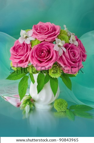 Bouquet with pink roses in a glass vase - stock photo