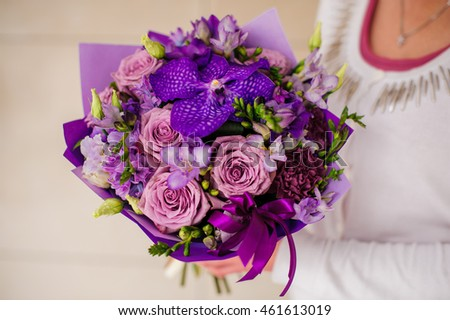 Bouquet with purple orchids, roses, Hydrangea flower in hands