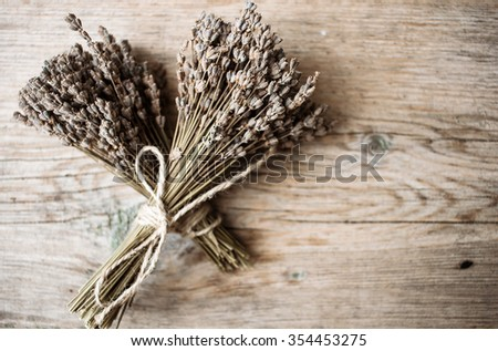 bouquets of dried Lavender on a wooden table