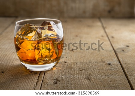 Bourbon scotch whiskey whisky glass fine art classy artistic rustic wooden barrel background