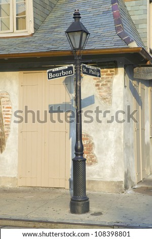 Bourbon Street and Lamp post in French Quarter of New Orleans, Louisiana - stock photo