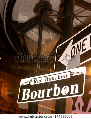 Bourbon street gas lamp and street sign. - stock photo