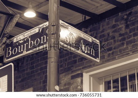 Bourbon Street Sign in New Orleans, the world famous Bourbon Street at French Quarter as party atmosphere. Vintage tone.