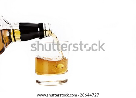 Bourbon Whiskey being poured into a glass - stock photo