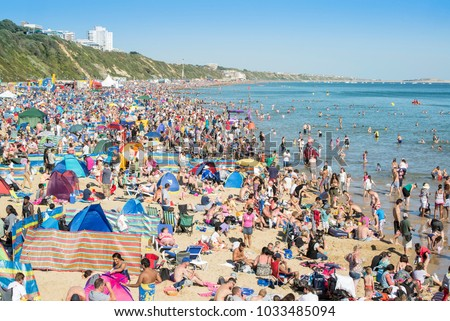 BOURNEMOUTH, UK - AUGUST 31, 2013: Record breaking crowd on the beach at Bournemouth Air Festival 2013.