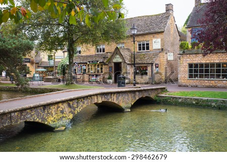 BOURTON-ON-THE-WATER, UK - OCTOBER 12, 2014:  View of scenic Bourton on the Water in the Cotswolds.  - stock photo