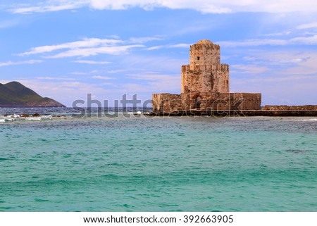 Bourtzi bastion surrounded by the sea in Methoni, Greece