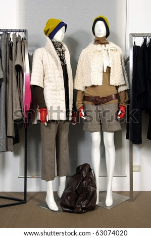 Boutique display mannequins in fashionable dresses - stock photo