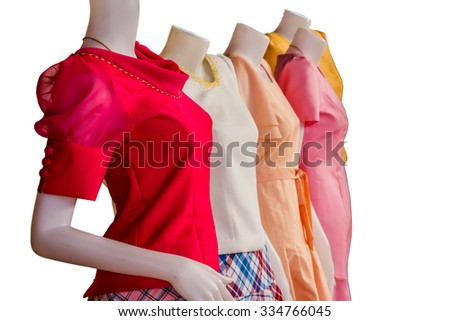 Boutique display window with mannequins in fashionable dresses Thailand Set isolate on white background with clipping path - stock photo
