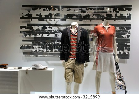Boutique in paris, pret a porter fashion in store window. - stock photo