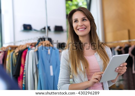 Boutique owner using a digital tablet