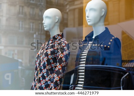 Boutique window with fashion mannequin - stock photo