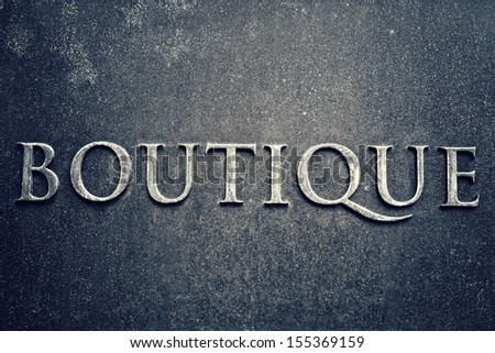 Boutiques sign on a metal plate. Business concept - stock photo