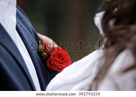 boutonniere and beautiful wedding accessories