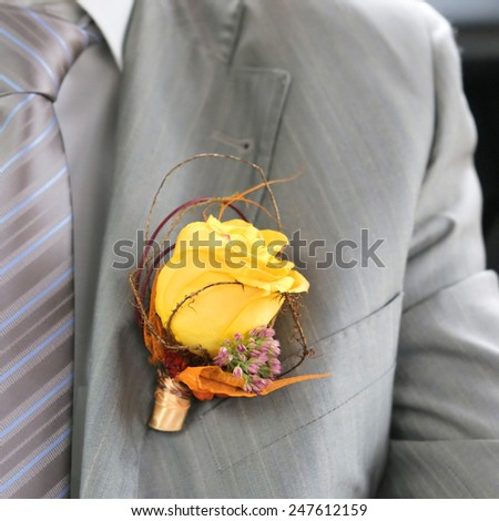 Boutonniere groom close up - stock photo