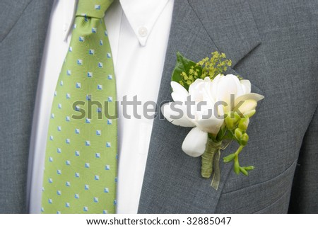Boutonniere on Grey Suit,green tie - stock photo