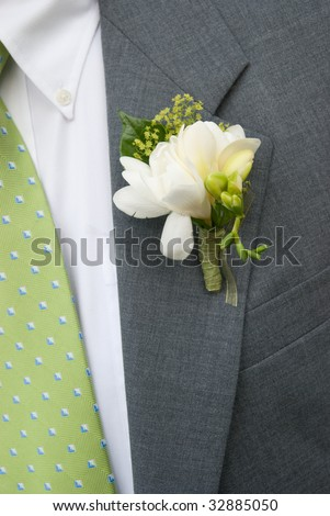 Boutonniere on Grey Suit w/green tie - stock photo