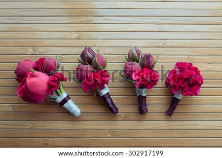 boutonniere with red rose and peony for groom and friends - stock photo