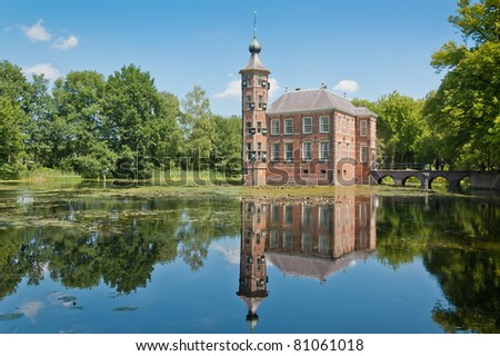 Bouvigne castle with pond and nice reflections in the water. The castle is located south of the Dutch city of Breda. The construction began in the 15th century. It is an official wedding location. - stock photo