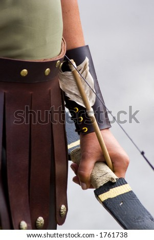 Bow and arrow before the shot. - stock photo