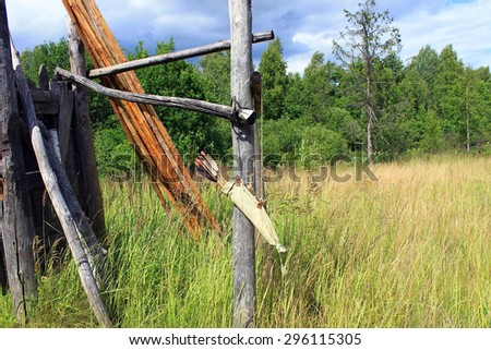 Bow arrows quiver hanging on wood ruins