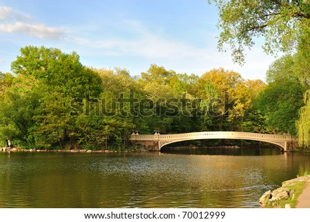Bow Bridge in Central Park, New York City, spanning the Lake. - stock photo