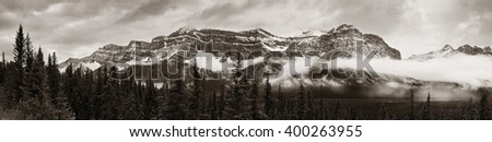 Bow Lake panorama with snow capped mountain and forest in Banff National Park - stock photo