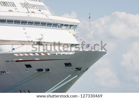 Bow of a luxury cruise ship tied up at port - stock photo