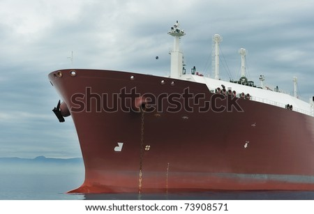 Bow of an anchored liquefied gas carrier - stock photo